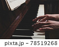 Caucasian woman playing piano in dark. Close-up. 78519268