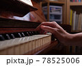 Girl and piano at home. Selective focus. 78525006