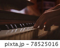 Woman playing piano. Close-up. Fingers on keys. 78525016