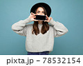 Photo of Beautiful positive woman person wearing black hat and grey sweater holding mobilephone 78532154