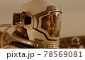 Female cosmonaut recording video during expedition on Mars 78569081