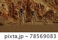 Male and female cosmonauts walking on Mars 78569083