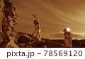 Astronauts climbing rocks and looking away on Mars 78569120
