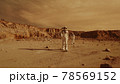 Female astronaut admiring terrain of Mars 78569152