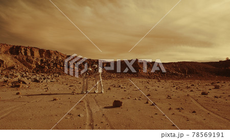 Astronauts discussing base location on Mars 78569191