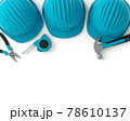 Top view of green construction tools for repair and installation on white 78610137