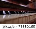Close up of black, white piano keys. 78630165