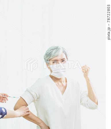 Senior asian woman receiving the injection of the coronavirus vaccine by a nurse to receive the antibodies, immunize the population. 78722803