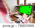 Woman using laptop with green screen. Business, communication, freelance and internet concept. Working at a laptop at home 78803966