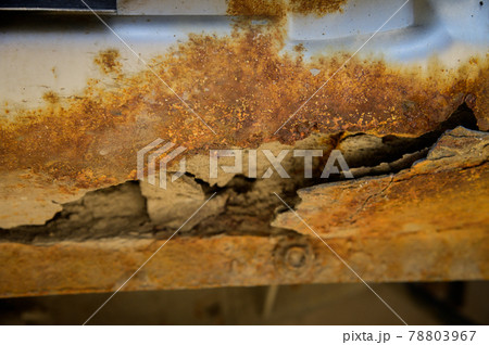 Fragment of a car body with rust. fragment of a rusty wing of a car. The body element is corroded. Concept: corrosion resistance, body repair, rust. Protection. 78803967