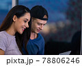 Young couple relaxing and enjoying at home on sofa with laptop. 78806246