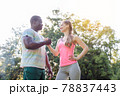 Black-white couple getting some motivation for sport exercise 78837443