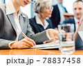 Close-up on woman taking notes during business meeting 78837458