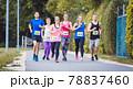 Group of marathon athletes running on street 78837460