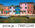 Small Multi Colored Houses and Canal with Boats in Burano Island - Venice Italy 78851246