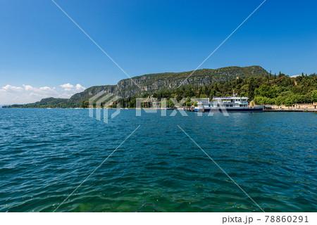 Coastline on Lake Garda and the Headland of San Vigilio - Garda town Italy 78860291