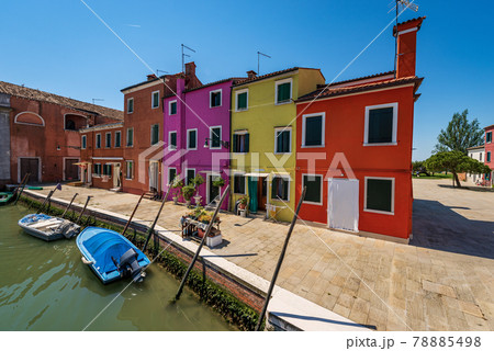 Small Multi Colored Houses and Canal with Boats in Burano Island - Venice Italy 78885498