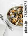 Herring with potatoes close-up, light background, fresh salted herring with baked potatoes on a light plate 78890978