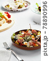 Classic tuna nicoise salad with egg, potatoes, s, tomatoes, anchovies, onions and olives, vinaigrette sauce, author's nicoise serving. 78890996