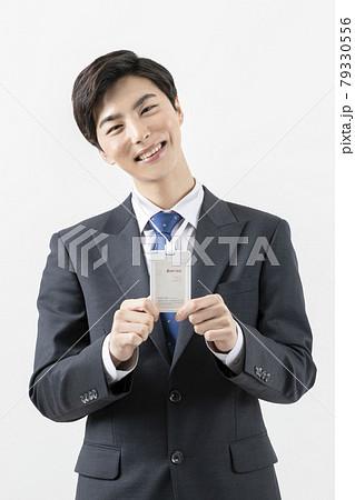 happy Asian man showing employee id card 79330556
