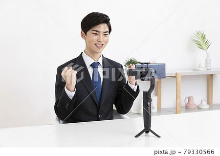 Asian young man in suit preparing untact online interview using smartphone 79330566
