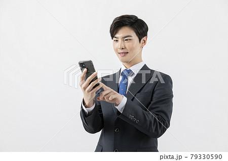 Asian man businessman employee checking smartphone 79330590