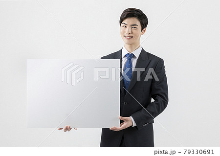 happy Asian man with copyspace banner 79330691
