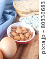 blue cheese, brown bread, egg and almond nut on table. 80336683