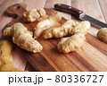 Close up of Gingers on chopping board. 80336727