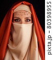 Close Up Portrait Of Beauty Young Muslim Woman In Hijab Looking At Camera 80398955