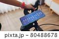 woman ride exercise bike 80488678
