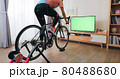 woman ride exercise bike 80488680