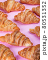 baked croissants lie on a pink background 80531352