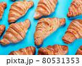 freshly baked croissants lie on a blue background 80531353