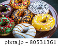 donuts with different flavors of frosting on a platter 80531361