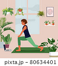 Stay at home concept, young woman excercising over a video call in a living room decorated with indoor plants 80634401