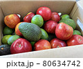 Food delivery box of fresh fruits such as avocado, apple and feijoa 80634742