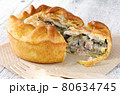 Close up of chicken and mushroom pie on a wooden table 80634745