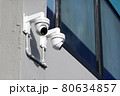 CCTV surveillance camera installed on concrete wall outside the building 80634857