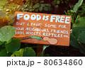 Community garden, Food is free sign in vegetable garden 80634860