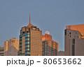 Full Moon setting behind building at hong kong 22 July 2021 F 80653662