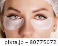 Eyelash Extension Procedure. Woman Eye with Long Eyelashes. Close up, selective focus. 80775072