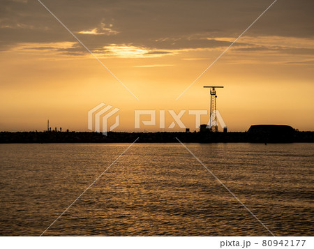 View of the harbor wall with anglers 80942177