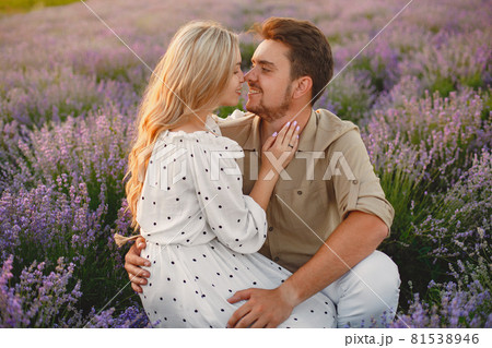 Woman in a white dress with her husband in a lavender field 81538946