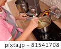 Woman confectioner making sweets in the kitchen 81541708