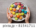 Concrete plate with colorful nut shaped desserts 81541711