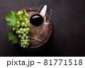 White grape, glasses on old wine barrel 81771518