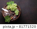 Wine glass and white grape on old barrel 81771520