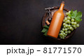 Wine bottle and white grape on old barrel 81771570