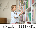 Young girl searching for the right books 81864451